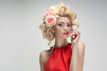 Fabulous young woman with a flower hairstyle