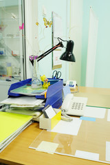 Doctor office table with office tools and lamp