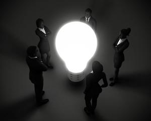 Executive team around light bulb of ideas.