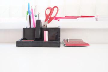 Office supplies including a calculator, stapler, scissors