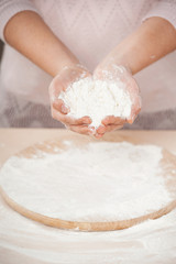 Close up photo of flour in female hands