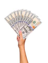 Dollars bills in female hand isolated on white. Money