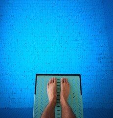 feet on diving board