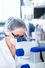 Young female microscopist