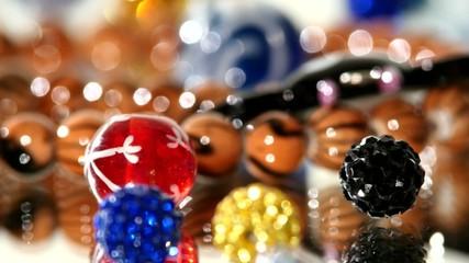 Brilliant, shiny, beautiful beads on white background, rotation