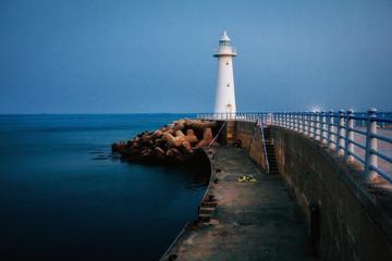 White lighthouse at dusk