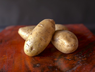 Fresh potato on dark background