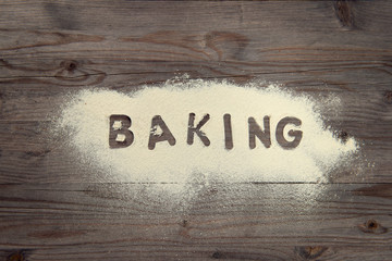 Word baking written in white flour