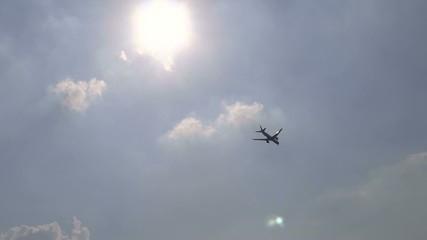 Aeroplane passing under the sun.