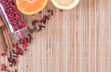 red peppercorns in glass on wooden background