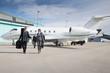 Leinwandbild Motiv executive business team leaving corporate private jet