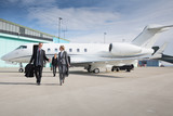 executive business team leaving corporate private jet