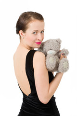 attractive smiling brunette holding teddy bear