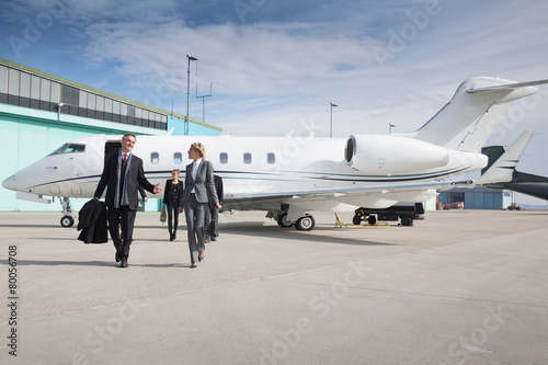 canvas print picture executive business team leaving corporate private jet