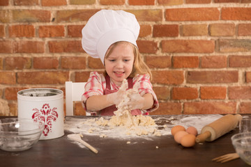 Happy little chef in the kitchen