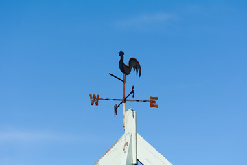 Weather vane on top of building