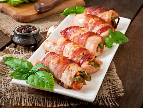 Fotobehang Assortiment Delicious chicken rolls stuffed with green beans and carrots