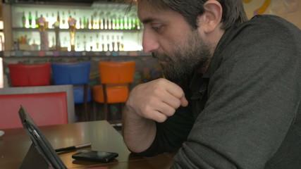 Businessman thinking in a bar