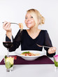 Woman is eating spaghetti