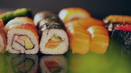 Delicious sushi pieces in row