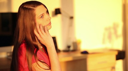 Attractive young brunette woman using smartphone