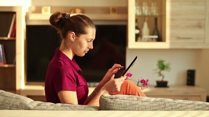 Young brunette woman using tablet