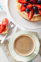 Coffee and tartlet with custard and berries