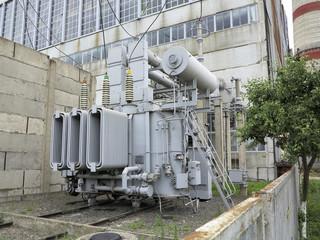Huge industrial high-voltage substation power transformer on rai
