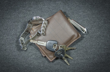 Wallets and car key of wristwatch have clippers
