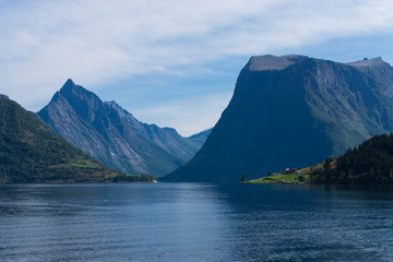 Beautiful view fjord, village and mountains of Norway.