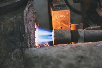 Metal pipe feeding fire into furnace