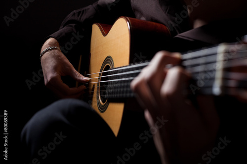 Man playing classic guitar - 80069389