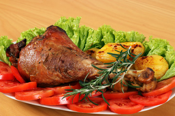 drumstick with vegetables on plate