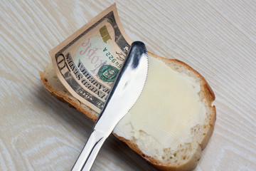butter and money on a slice of bread
