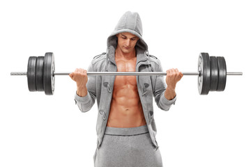Young male bodybuilder exercising with a heavy barbellell