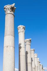 Ancient columns on blue sky background, Izmir, Turkey