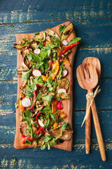 Vegetable salad on olive wood cutting board
