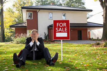 Estate agent sitting outside the house