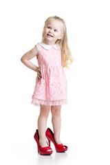 Toddler girl wearing big shoes