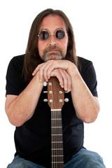 Portrait of man holding a guitar