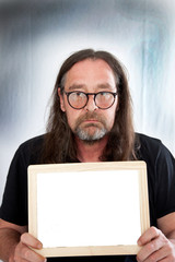 Long Hair Man Holding Small Blank White Board