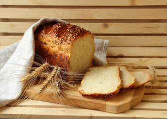 Homemade bread and stalks of wheat.