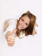Woman looking through paper hole