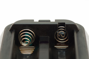 Black plastic battery holder with metal connectors