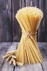 Pasta with ears on wooden background