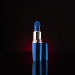 Blue lipstick isolated with glossy reflection