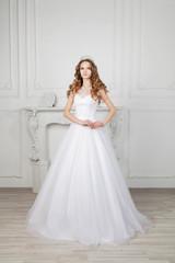 Slim beautiful woman with long hair wearing luxurious wedding