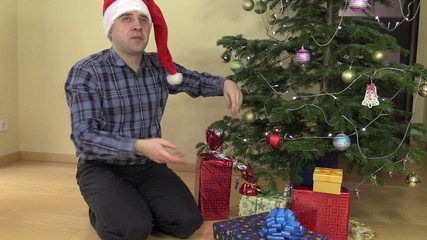 Cheerful family man catch gift box and put under Christmas tree