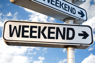 Weekend direction sign on sky background