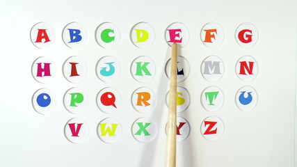 The video shows English alphabet images on paper